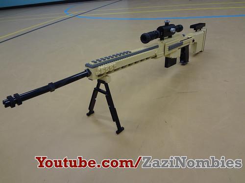 Видео как сделать из лего пистолет стреляющий