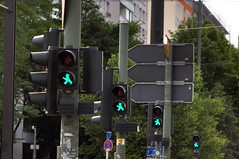 Four Green Men Walking in Berlin (Blue Rave) Tags: 2012 germany europa deutschland europe berlin lights light illuminated vanishingpoint pathway illumination path back backside diagonal people walking destinationunknown ampelmann walkinginrhythm walk walkng green