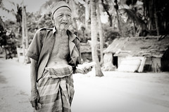 Old man and papaya (Marcus Revertegat) Tags: travel blackandwhite bali seaweed indonesia island noiretblanc nb lembongan indonsie