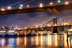 Bridges to the Empire State (DPGold Photos) Tags: nyc bridge light ny newyork color reflection skyline brooklyn night cityscape nightscape manhattan empire brooklynbridge manhattanbridge empirestatebuilding lighttrails dpgoldphotos