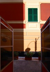 Gli oleandri (meghimeg(temporarily disconnected)) Tags: shadow reflection lamp facade colours ombra telefono chiavari colori 2012 lampione riflesso cabine facciata