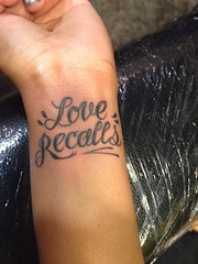 love recalls script tattoo by Wes Fortier