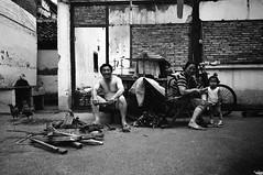 Family (Woods | Damien) Tags: china wood family blackandwhite house chicken film contrast shanghai noiretblanc destruction chinese demolition push recycling argentique ricohgr1v lifeintheslowlane 拆 ilfordxp2400super