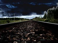 Dark Line (the real Kam75) Tags: clouds ties bed weeds rail line poles gravel