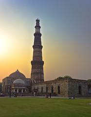 Qutub Minar Edit #1 (AnkurDauneria) Tags: world travel india green art heritage texture tourism monument architecture century canon garden temple eos evening asia muslim tomb scenic mosque historic unesco mausoleum monarch historical 1855mm visitors hindu 12th efs emperor qutubminar quran asi towerofvictory redstone mughal rajput historicindia greenary iltutmish incredibleindia victorytower indraprastha apsc qutubuddinaibak 27hindutemples