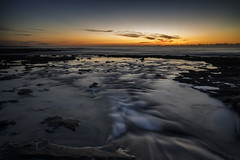 Emptying Into the Cowrie Hole (Leighton Wallis) Tags: water sunrise newcastle dawn waves empty sony australia running nsw newsouthwales pancake alpha 16mm f28 newcastleoceanbaths mirrorless a7r ilce7r