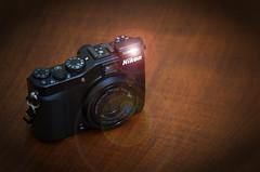 """""""La Nikon P7000 sin la persiana de protección del objetivo"""" (Marcelo Savoini) Tags: nikon repaired p7000 reparada"""