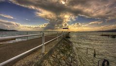 the lake (Guido Pezzatini) Tags: travel light sunset sky italy sun lake storm water clouds italia tramonto ray cielo acqua luce umbria raggi