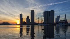 Sunset (R. Engelsman) Tags: sunset sky sun holland netherlands skyline architecture rotterdam nederland skycraper wilhelminapier rijnhaven