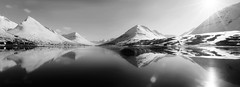 there is a place without up or down and no boundaries (lunaryuna) Tags: sky bw panorama sunlight seascape nature water monochrome beauty sunshine reflections landscape coast blackwhite iceland spring may fjord lunaryuna seeingdouble solarflare mountainrange snowcappedmountains olafsfjordur whatisreal northiceland seasonalchange northernmirrorworlds