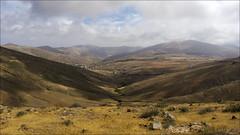 Betancuria - Fuerteventura (JLL85) Tags: sky panorama españa naturaleza mountain nature yellow clouds landscape island town view pueblo valle paisaje canarias amarillo cielo panoramica nubes vista canary montaña islas valey betancuria