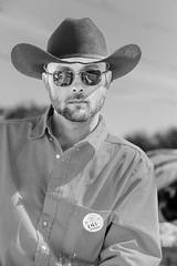 Cowboy (wyojones) Tags: houstonlivestockandrodeoparade texas houston houstonlivestockshowandrodeo parade trailride hat cowboyhat horse glasses sunglasses shades redshirt beard portrait outdoor wyojones