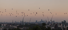 Balloon Regatta (Umbreen Hafeez) Tags: city uk roof light england hot building london eye st skyline architecture skyscraper sunrise dark balloons europe long exposure cityscape cathedral outdoor air low pauls wharf gb canary shard gherkin complex cheesegrater walkie talkie