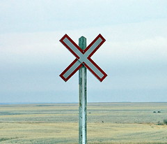 SKSW12d62 Railway Crossing Sign, Saskatchewan (CanadaGood) Tags: swiftcurrent prairie agriculture farm railway sign 2012 colour color red blue white sk saskatchewan canada thisdecade canadagood text railroad