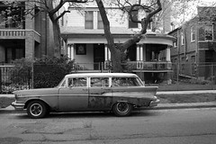 I've Traveled So Far (Flint Foto Factory) Tags: auto street old city family urban bw white chicago black brick classic chevrolet belair home car station wagon illinois spring rust automobile gm parking north rusty front neighborhood uptown chevy american porch 1957 april magnolia wilson americana intersection homestead parked residential kerb curb 2012 generalmotors 4door cedarlawn worldcars