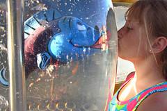 Thankfully, still the first kiss (mattleof) Tags: california ca city blue light orange fish water colors girl canon photography aquarium photo kiss photographer tank photos disneyland daughter powershot orangecounty fredrickson s95 mattfredrickson mattleof
