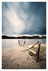 Abandoned (A-D-Jones) Tags: sky water fence landscape long exposure smooth reservoir rivington hitech 10stopper