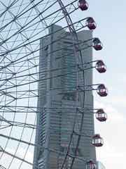 Big wheel keep on turnin' (kasa51) Tags: building japan digital lumix olympus panasonic ferriswheel yokohama minatomirai  gf1 yokohamalandmarktower 1250mm  f3563  mzuiko