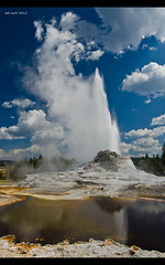 Castle Geyser, Old Faithful , Yellowstone National Park, WY, USA (Suchi-Deb) Tags: red sky orange cloud color reflection nature water colors yellow clouds landscape nikon colorful etsy geyser hotspring sapphire castlegeyser finegold oldfailthful flickrhearts flickraward flickrbronzeaward exemplaryphotos internationalgeographic d7000 nikonflickraward wideanglelandscape addictedtonature nikond7000 naturesprime bestshotawards bestphoto4gpinoct2011 geyses