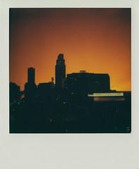 Thunderstorm Sunset (DavidVonk) Tags: city sunset sky orange storm film rain 30 skyline clouds analog vintage polaroid midwest beta instant omaha thunderstorm slr680 thunder impossibleproject 30beta color30beta