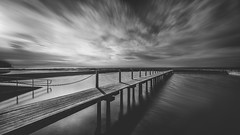 Bridge over trouble waters (scotty-70) Tags: bw water pool clouds sony voigtlander sydney australia nsw a7 narrabeen oceanpool
