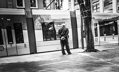The Inspector (TMimages PDX) Tags: road street city people urban blackandwhite monochrome buildings portland geotagged photography photo image streetphotography streetscene sidewalk photograph pedestrians pacificnorthwest avenue vignette fineartphotography iphoneography