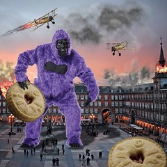 Jammy dodger apocalypse (Flamenco Sun) Tags: madrid war purple gorilla mashup attack apocalypse biscuit kingkong plazareal biplane jammydodger