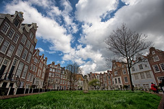 The enclave (Pat Charles) Tags: city travel houses urban holland tourism home netherlands dutch amsterdam statue architecture clouds nikon europe 1001nights exploration