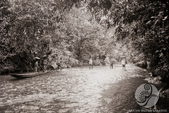 JB001-27-11-1956 (The Ulu and the Museum) Tags: people travelling river walking landscape boats outside boat other others community objects location daytime subject 1956 date riverbank timeofday tinjar menmorethanone longburoi villageorlonghouse