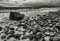 Minehead pebble beach, Somerset. (Robots are Stupid) Tags: ocean uk sea england blackandwhite bw seascape storm beach wet monochrome mono coast seaside nikon rocks waves cloudy britain stones tide wideangle somerset pebbles foam pebblebeach 24mm breakers stormbrewing rainclouds westcountry exmoor minehead bristolchannel roughseas angrysky wetrocks 24mmnikkor bridgwaterbay d700 nikond700 daviddalley davidjdalley