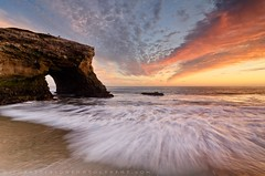 Light Falls on Natural Bridges (Jim Patterson Photography) Tags: ocean california statepark bridge sunset usa santacruz seascape beach landscape coast colorful arch natural coastal shore brilliant naturalbridges crescentmoon statebeach paciifc jimpattersonphotography jimpattersonphotographycom seatosummitworkshops seatosummitworkshopscom