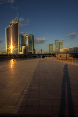 astana sunset reflections (mariusz kluzniak) Tags: new city blue sunset shadow sky modern clouds reflections asia long sony capital central rays alpha stretched incredible kazakhstan barren ultra steppe astana 580 a580