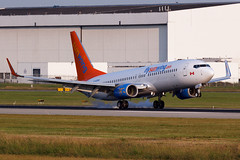 Sunwing Airlines | Boieng 737-86J | C-GOWG (Patrick Lundgren) Tags: travel sea sky orange sun canada grass vancouver clouds plane canon airplane island photography airport all smoke air tail wheels transport wing jet sigma gear columbia os richmond landing international airline british passenger airlines runway types airliner rudder liner | fuselage sunwing boieng 120300 73786j 60d cgowg