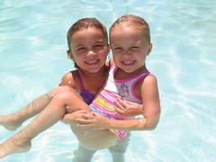 Swimming Fun (Beauty Playin 'Eh) Tags: sisters swimmingpool summertime summerfun funinthesun smilinggirls happygirls backyardfun kidsinthepool girlsintheswimmingpool fourthofjuly2012