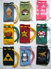 Dice bags! (doctormoo) Tags: game mushroom bag star video handmade crafts nintendo arcade spaceinvaders knit mario atari gaming pouch link videogame nes finalfantasy moogle legendofzelda goomba fireflower triforce dicebag blackmage invincibilitystar