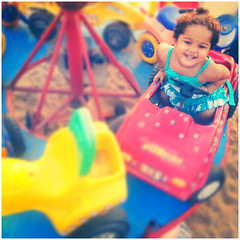 My daughter loves merry-go-round (VinothChandar) Tags: people india playing color colour love beach colors beautiful mobile marina happy photography photo kid colorful play photos pics path weekend vibrant go madras daughter picture vivid samsung pic galaxy enjoy round colourful merry merrygoround chennai s3 android tamilnadu babay instagram
