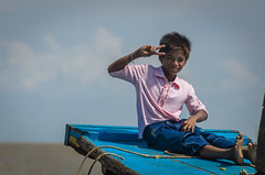Peace (Brian Hammonds) Tags: travel pink blue boy lake man color tourism water contrast children asian boats photography bay boat photo fishing nikon asia cambodia peace cambodian village child bright south young picture vivid floating tourist east adventure traveling southeast sap tonle d7000