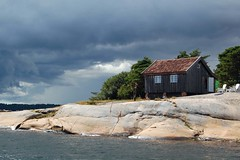 Bad weather approaching (Linepusle) Tags: storm rain clouds grey cabin chairs stfold hytte gr svaberg adirondac engelsviken vrbitt regnskyer
