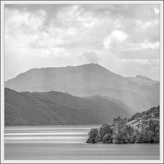 Urquhart Castle (spodzone) Tags: light sky blackandwhite mountains building castle art nature lines composite clouds manipulated square landscape photography scotland highlands emotion unitedkingdom space places calm appreciation serene distance toned contrasts hdr stacked existentialist drumnadrochit goldenratio digikam tonemapped landwater skyearth shapeandform cloudappreciation rawconversion enfuse rawtherapee luminancehdr darktable mankindnature
