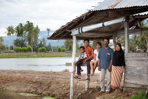 Shrimp farmer Rusli and his family, Aceh, Indonesia. Photo by Mike Lusmore/Duckrabbit, 2012.