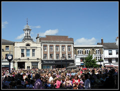 Town Square (Jon 89) Tags: old uk blue summer england sky people sun hot building english history clock sunshine weather june shop clouds buildings children square happy town photo community warm day tour elizabeth view place market britain jubilee south united great crowd royal police kingdom sunny visit scene location flags historic diamond celebration queens ii gb shops british welcome schools 14th spectators visiting celebrate occasion highness hertfordshire hitchin celebrating policeman 2012 thequeen waterstones cornexchange herts thousands quepasa hermajesty osinskys
