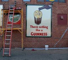 Nothing Like a Guiness (Photographs By Wade) Tags: oklahoma sign advertising bucket ad advert scaffold ladder tulsa guiness cherrystreet kilkennys
