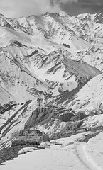 Nestled Amidst Montains [I] [BW] (Modesto Vega) Tags: cloud india mountain snow monochrome blackwhite nikon monastery himalayas ladakh lamayuru himlayanroad