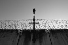 (Andrus Lall) Tags: light white black abandoned architecture contrast vintage frames wire shadows places symmetry prison frame framing barbed