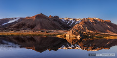 Pond Reflections (John Fn Photography) Tags: blue sunset sky panorama sun white snow mountains cold water rock mirror iceland spring still pond nikon quiet seasons pano peaceful panoramic calm cliffs serenity snowing nordic tundra manfrotto 1635mm d810 republicoficeland