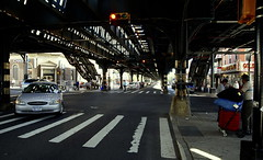 Elevated Train On Broadway and 232nd Street In The Bronx NYC (nrhodesphotos(the_eye_of_the_moment)) Tags: dsc0789414x85 theeyeofthemoment21gmailcom wwwflickrcomphotostheeyeofthemoment bronxny broadway 132ndstreet auto train mta shadows reflections perspective people pedestrian car beams roadway streetlight metal lanes crosswalk buildings signs stores urban outdoor stairs stations transportion mtaelevatedtrainstructure cart wagon light dark contrast pipes marblehill