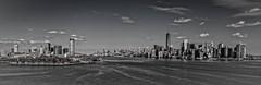 New York Skyline Panoramic View (mdavies149) Tags: sky bw newyork water monochrome skyline america buildings river nikon cityscape skyscrapers manhattan ngc eastriver hudsonriver ellisisland thebigapple d600 michaeldavies
