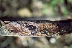 Fe2O3.nH2O (mikeasaurus) Tags: brown color colour macro texture metal closeup germany bayern bavaria rust kodak 200asa split braun rost ricoh cracked farmequipment oberflche kr10x march2012 rikenon3570mm foundinthesurfzone