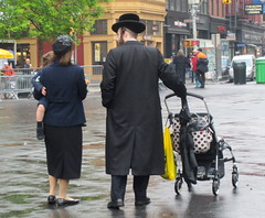 Hasid Family in Union Square (SHOTbySUSAN) Tags: nyc newyorkcity newyork toddler manhattan streetscene jew unionsquare hasidic familyshot babycarriage hasid orthodoxjew hassid jewishfamily shotbysusan rainydayscene