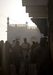 Crowd In A Street Of Lamu, Mosque In Background, Lamu, Kenya (Eric Lafforgue) Tags: 113635 color vertical lamu kenyaafrica exterioroutdoors minaret backlighting crowd street scene photography swahili eastafrica lamuisland unescoworldheritagesite backlit maulidifestivalbarazacultureculturalgathering traveldestination mawlid kenya tradingroute kea africa afrika afrique a       qunia qunia culture tradition lafforgue island